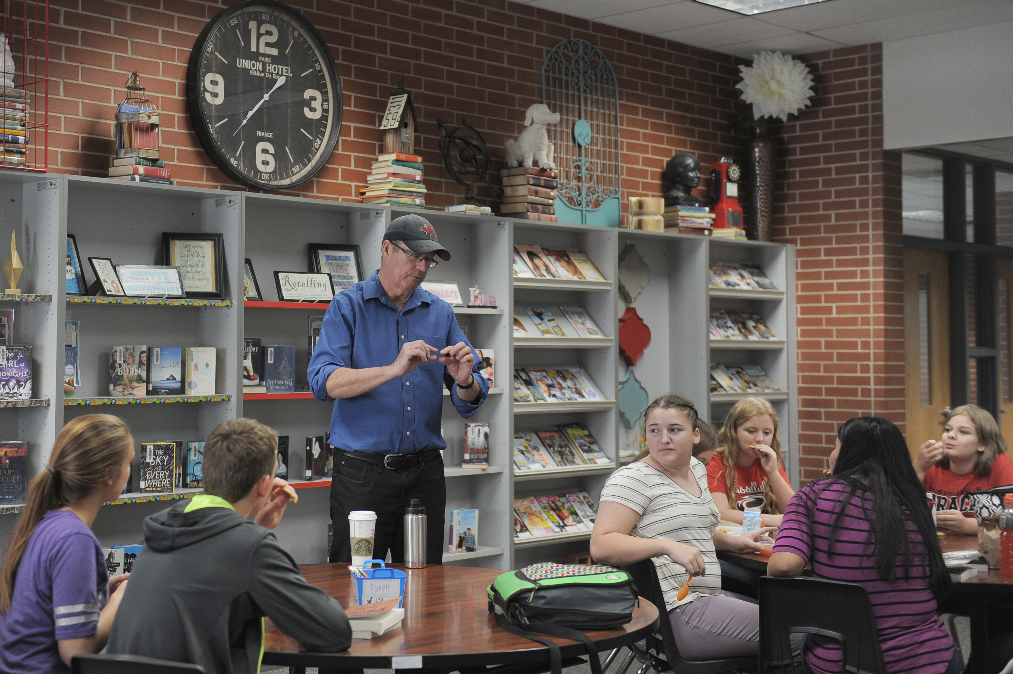 Author Eric Walters visits with RJHS students about his books in the library.