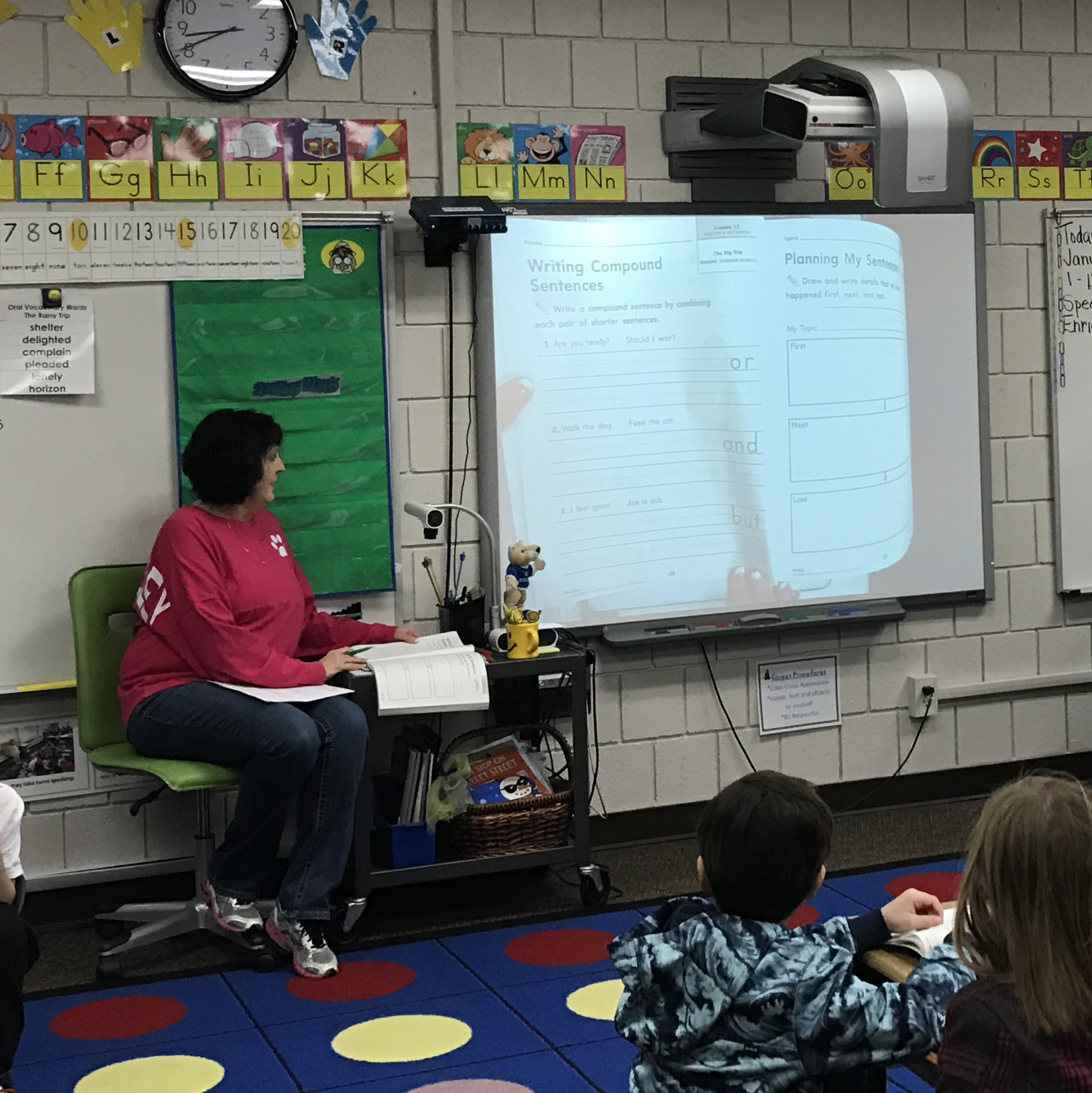 teacher using smartboard