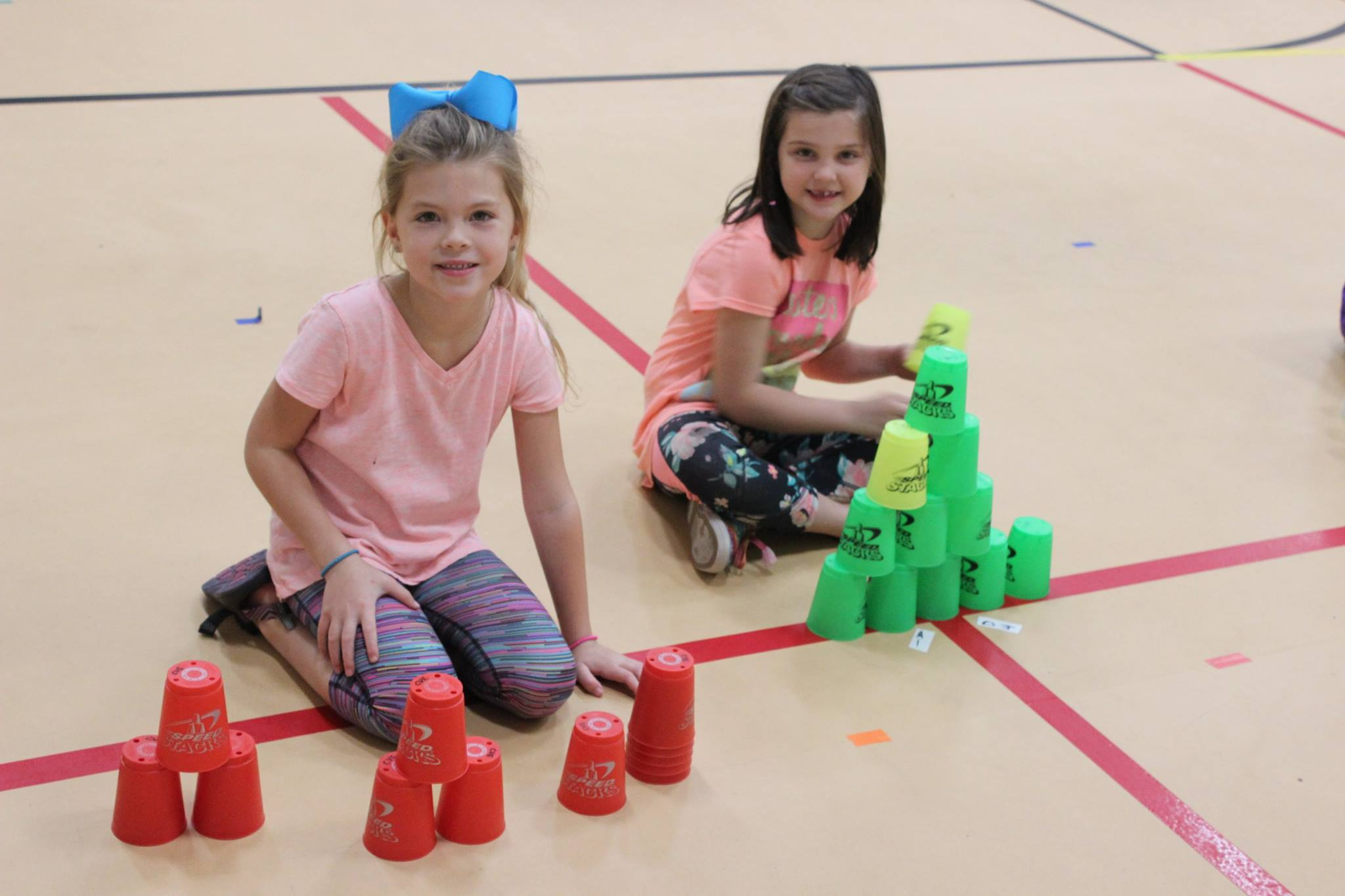 students doing cup stacking