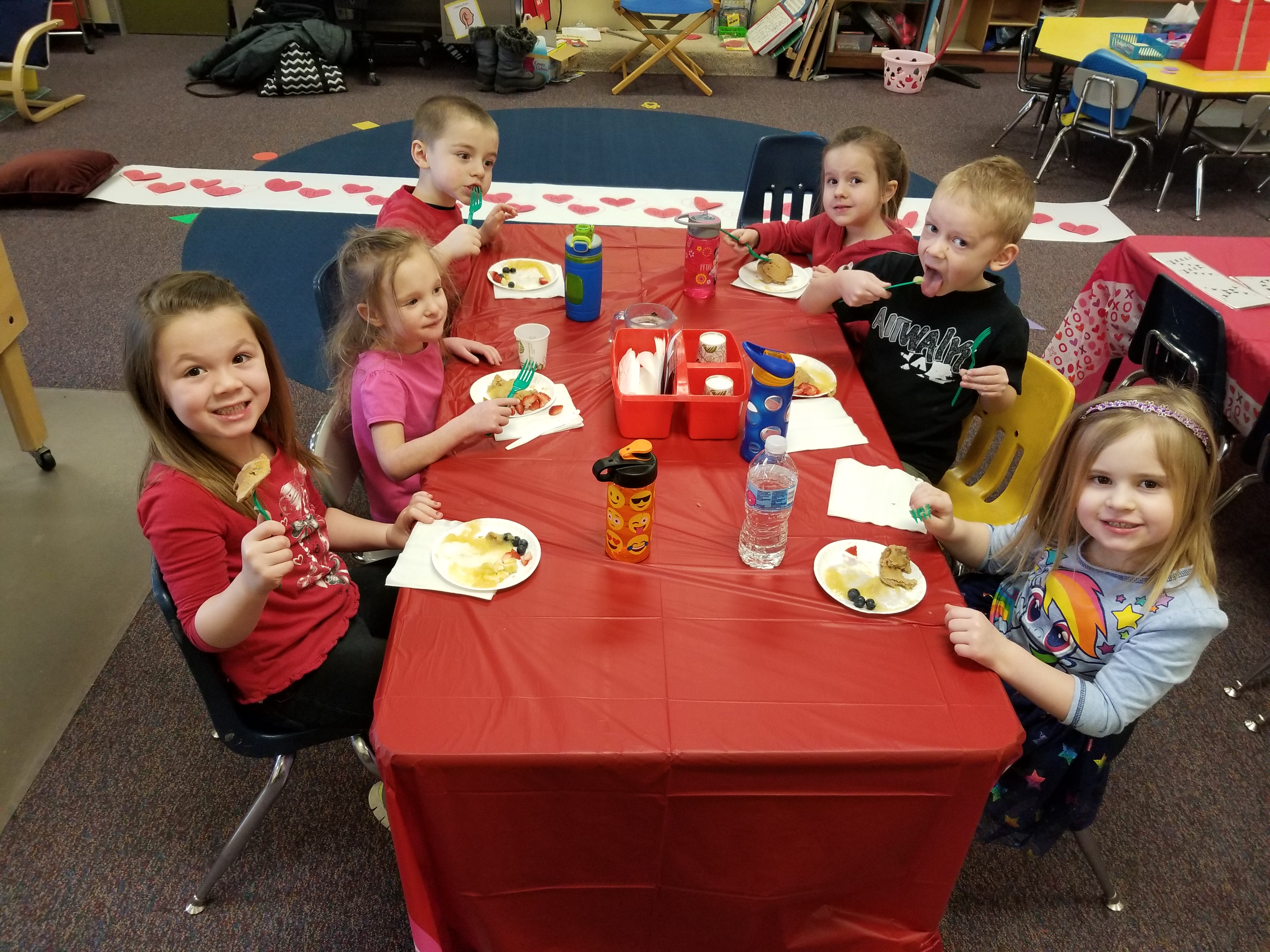 Students enjoy cooking pancakes on Valentine's Day.