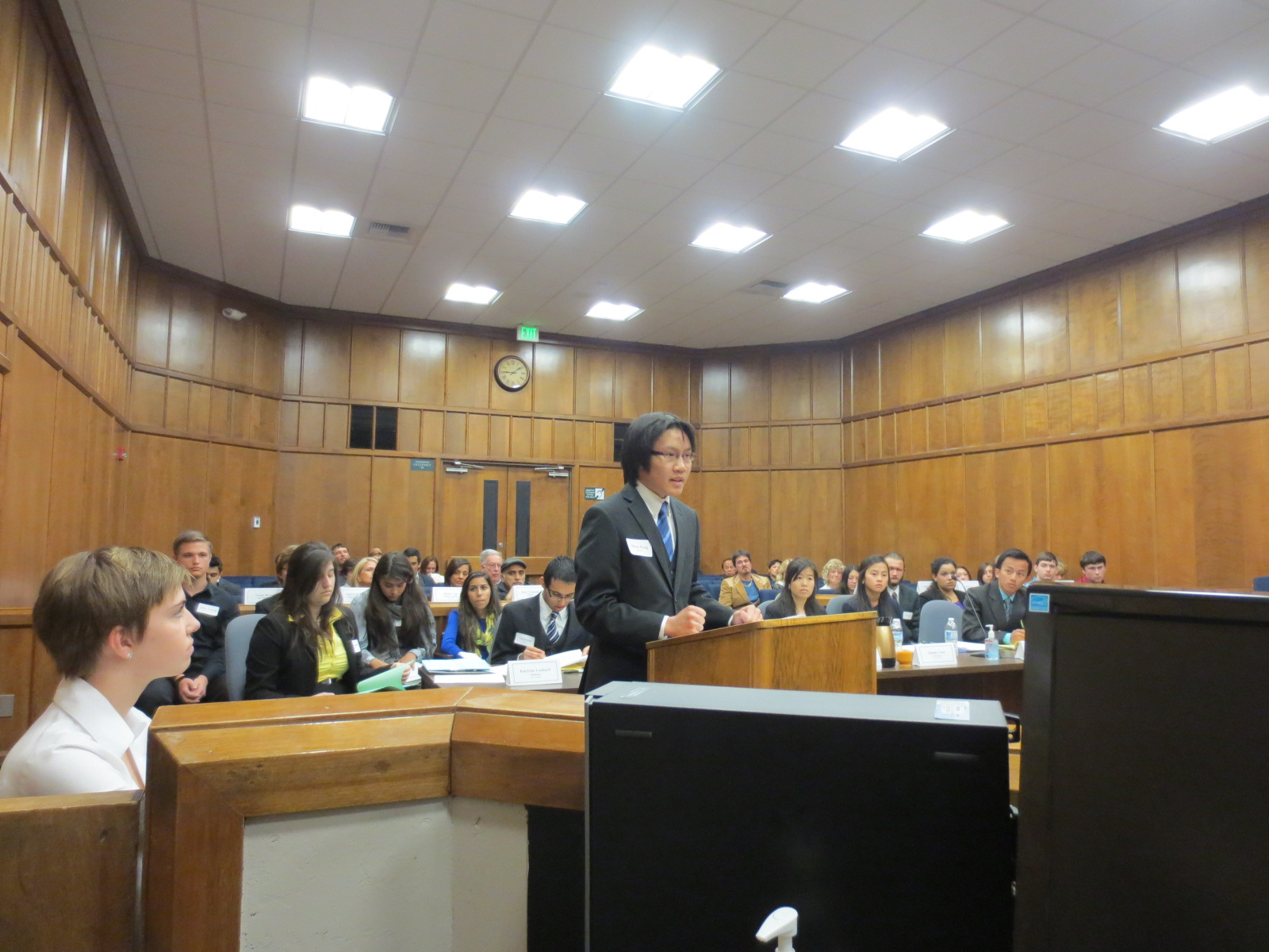 Photo of student at podium in court room making a case during mock trial