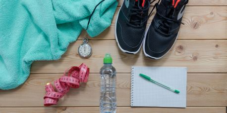 towel, stopwatch, shoes, water bottle, measuring tape, paper, pen