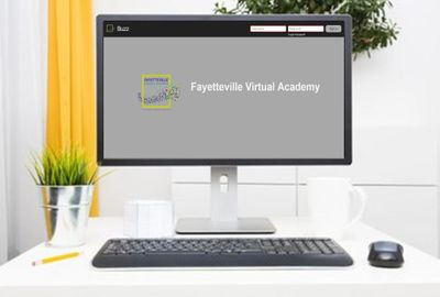 Computer with Fayetteville Virtual Academy Logo