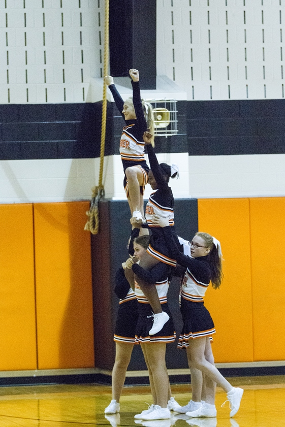 Cheerleaders forming a pyramid