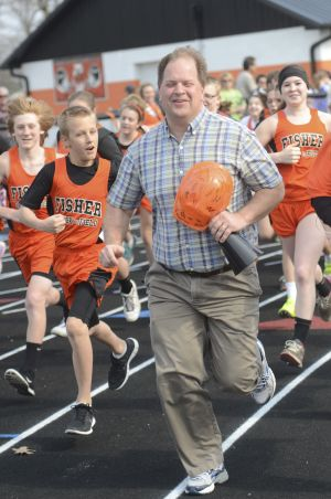 Chairman of the Fisher Track & Stadium Renovation Committee led the Fisher Jr. High Track Team on a Ceremonial 1st Lap Around the Track
