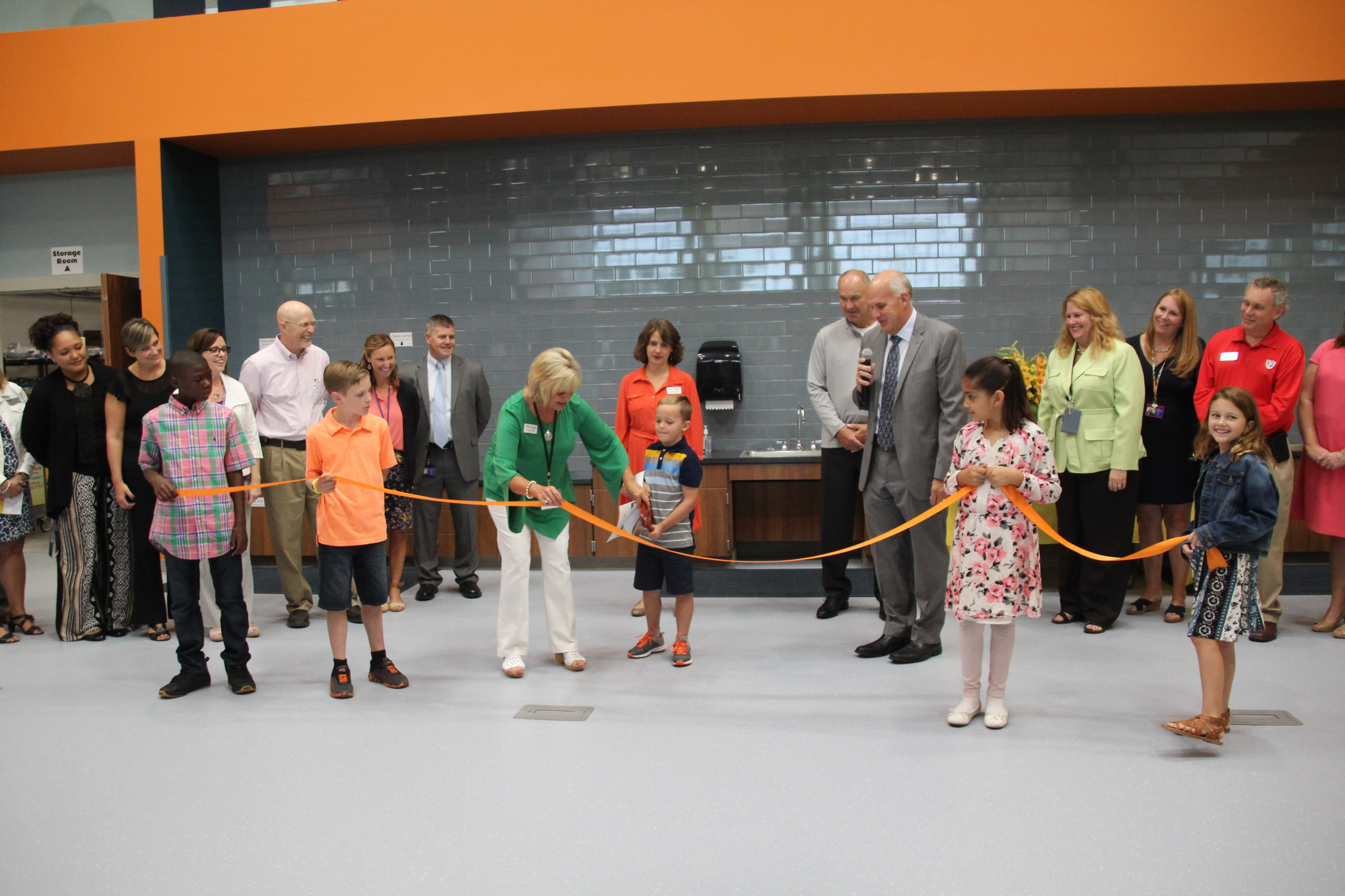 Students participating in the ribbon-cutting of The Imagination Lab