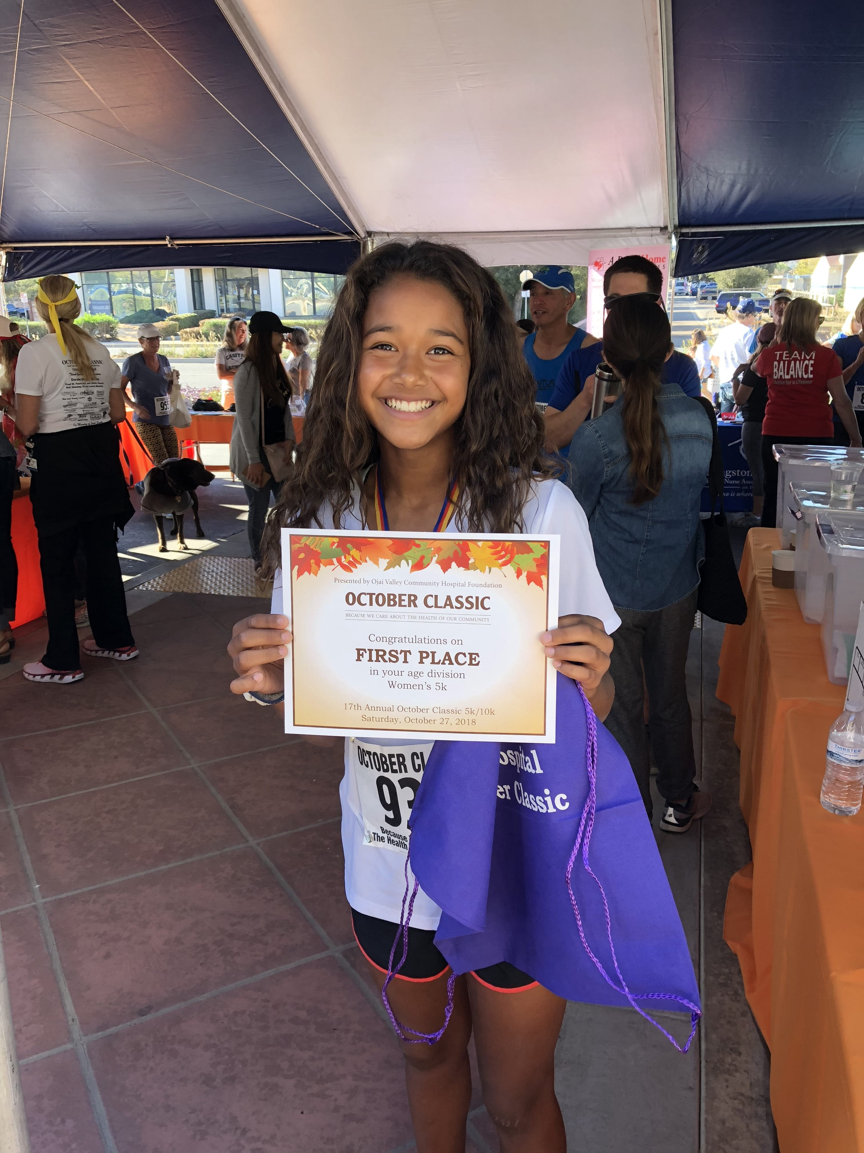 A Matilija student showing off her first place award