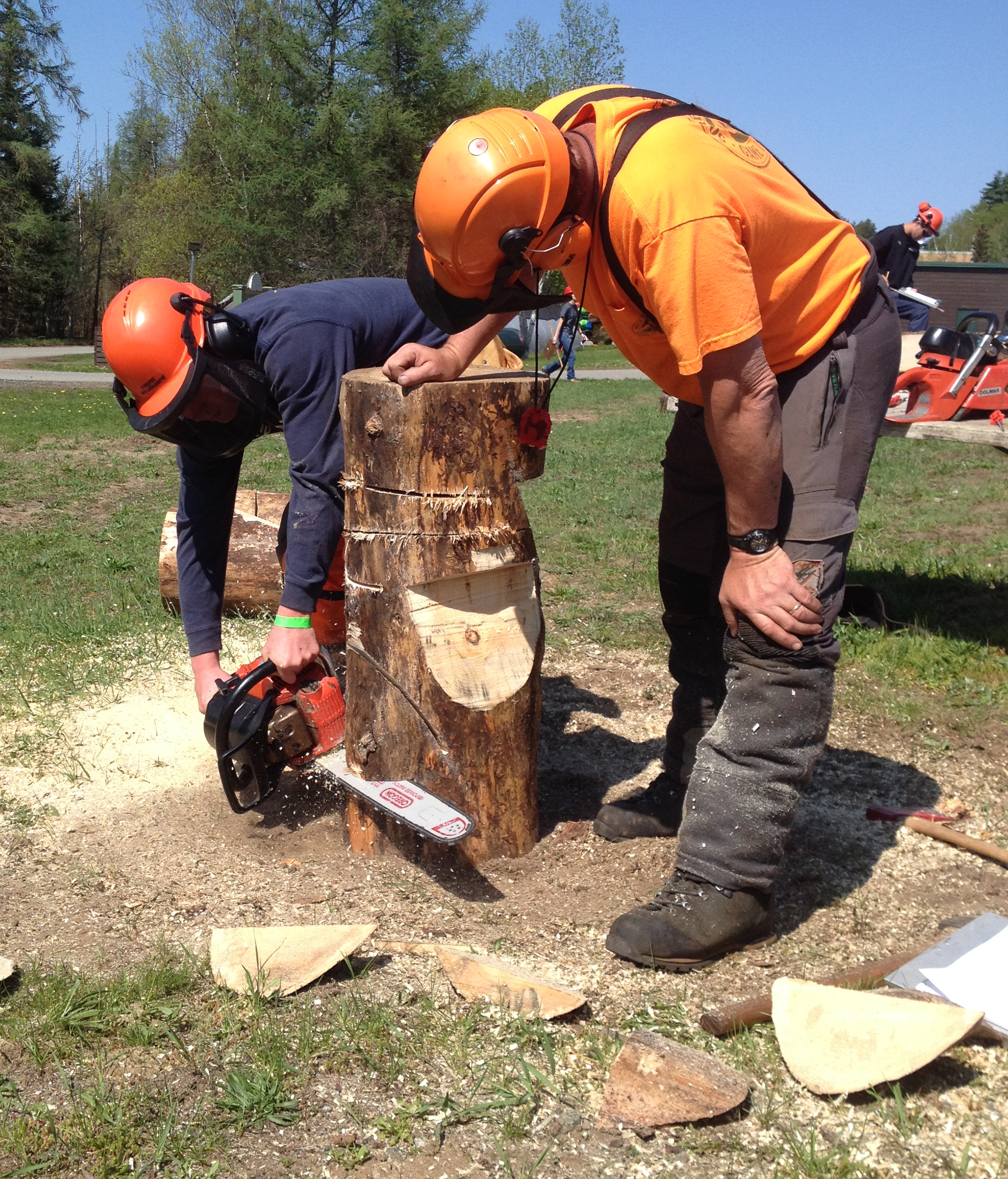 student works with chainsaw
